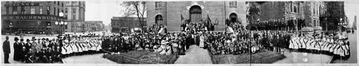 1912 photo of group of people outside, gathered.