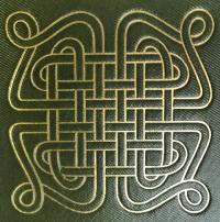 Gold knot on green cover of book