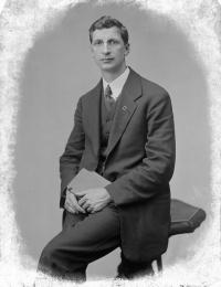 De Valera seated, in suit.