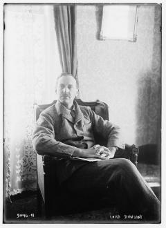 Lord Dunsany, seated in suit and tie.