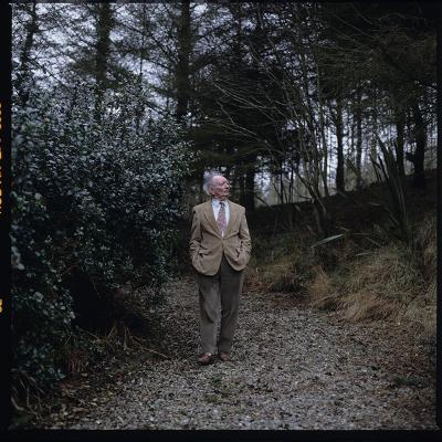 Brian Friel walking in the woods.