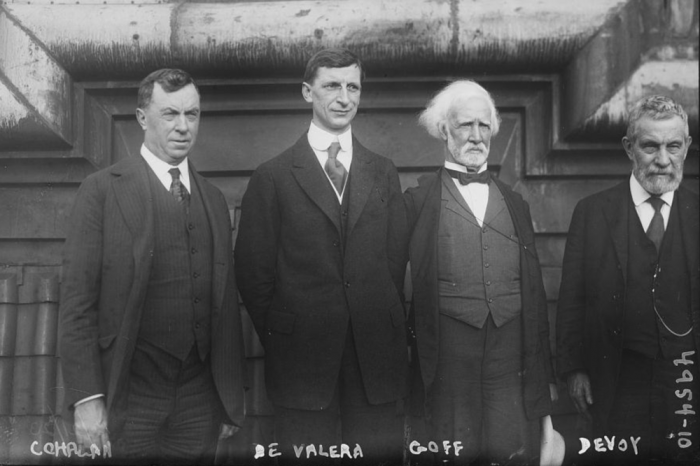 Four men in suits post for photo in 1919.