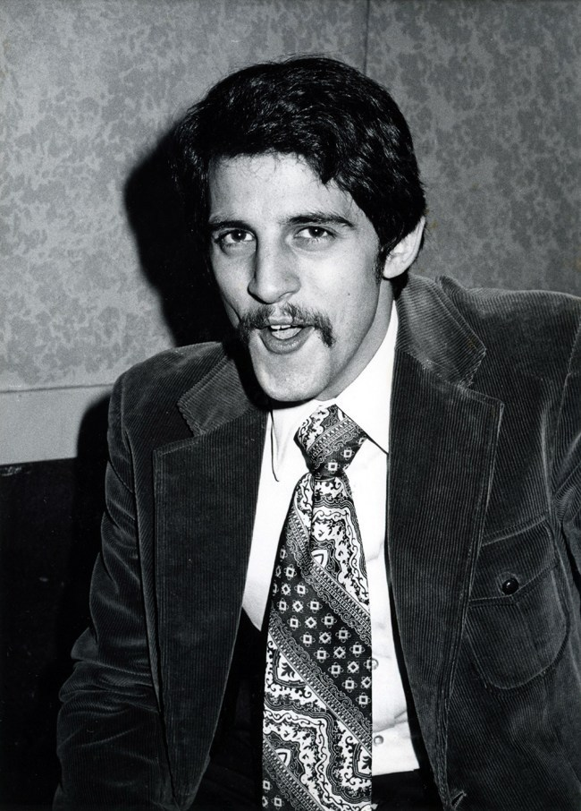 Oh where to start? A handsome dark haired man with a full mustache and even fuller tie, looking into the camera with an unfortunate (and funny) expression on his face. Did I mention the tie? Huge. Patterened. Magnificent.
