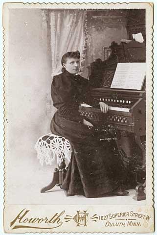 Woman seated at organ, 1895. Advertisement.