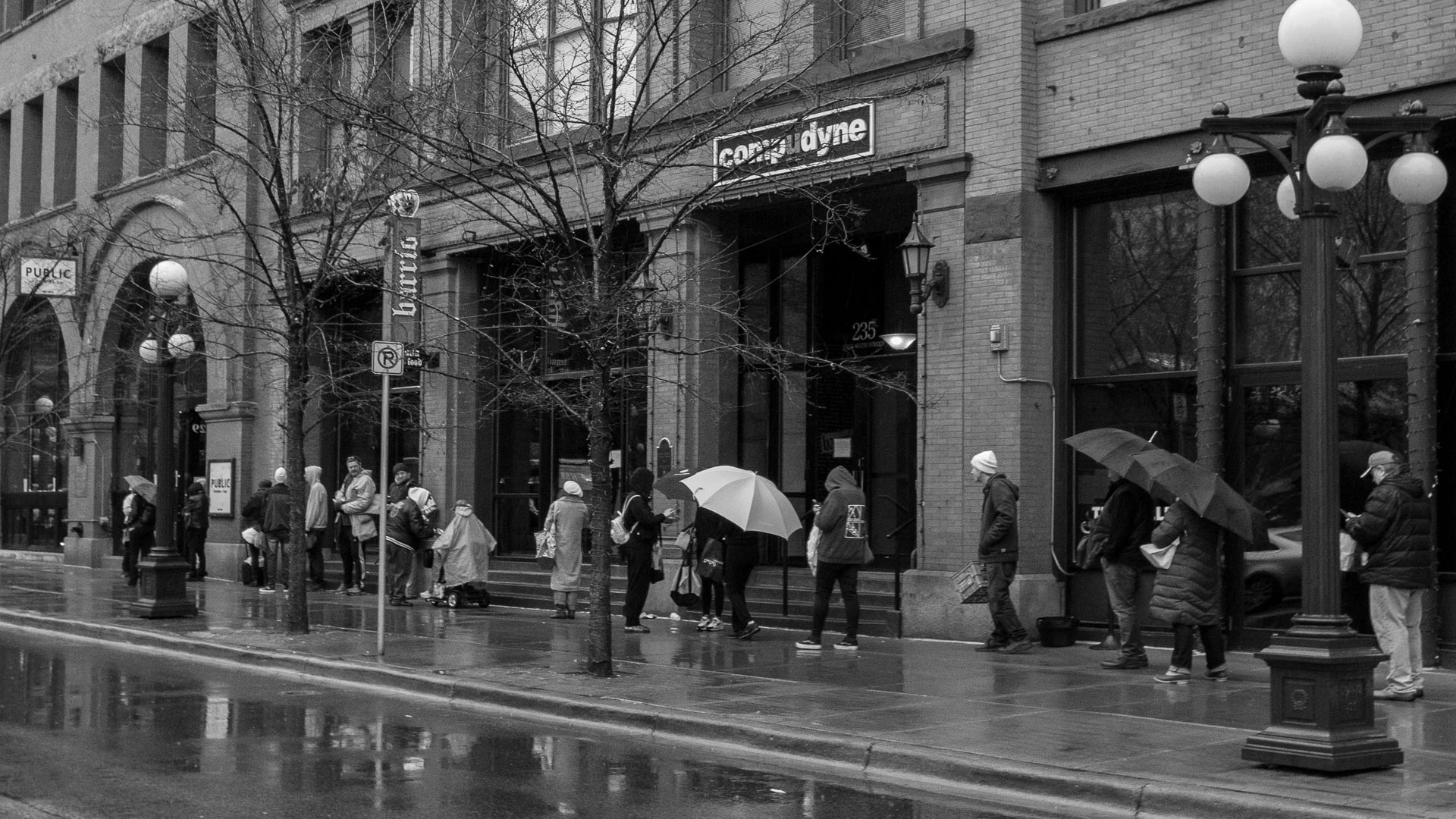 Street photography by Tom Dunn. Waiting in line for perishable food during the lockdown.