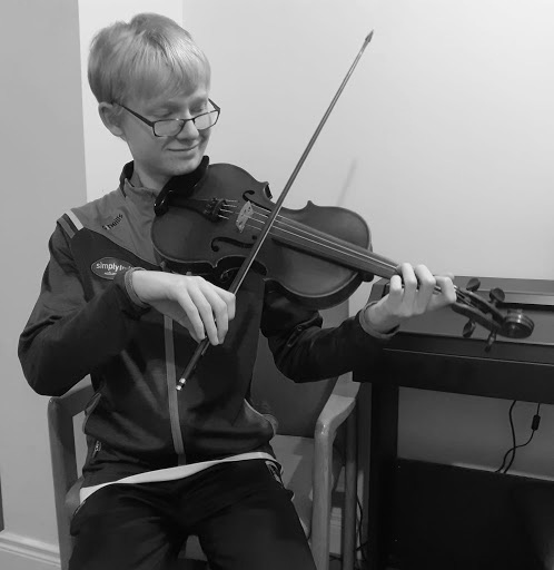 Aodh Mac Murchaidh playing fiddle, composer of Kindred Spirits